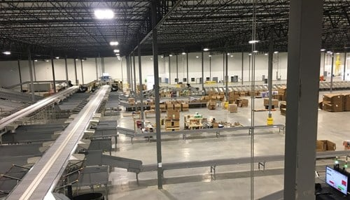 The center is powered by 63 robots that perform put-away and picking functions.