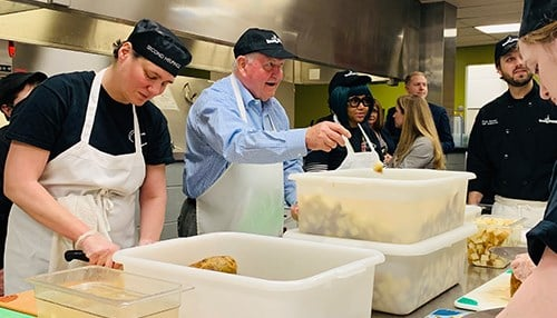 Perdue visited the culinary job training students at Second Helpings in Indianapolis.