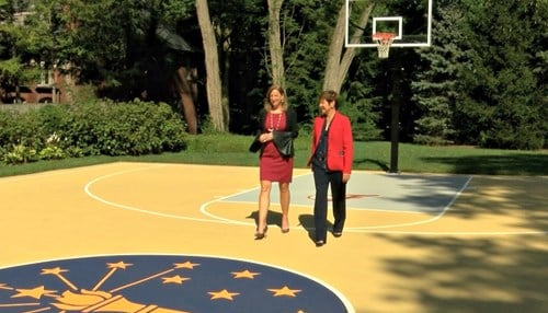 WNBA Commissioner Cathy Engelbert chats with Fever President Allison Barber.