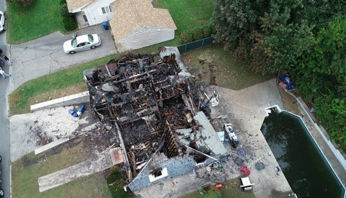 An aerial view of a burned-out home impacted by the natural gas explosion and fire in Merrimack Valley, MA. (Photo ctsy: NTSB)