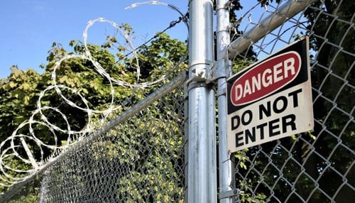 An abandoned East Chicago neighborhood is fenced off for safety. (photo ctsy: The Times of Northwest Indiana)